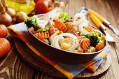 foto of fried chicken  - Fried chicken with vegetables in the frying pan  - JPG