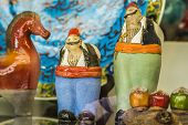 foto of national costume  - ceramic figures of Turkish men in their national costumes on the market - JPG