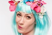 pic of headband  - Girl with flower headband and crazy wig shot in the studio on white background - JPG