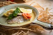 foto of hake  - Fish fillet with artichokes and tomatoes with lemon - JPG