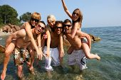 stock photo of party people  - Group of friends having fun at the beach - JPG
