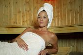 foto of swedish sauna  - Beautiful woman in a sauna cabin - JPG