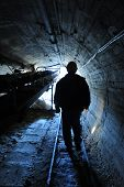 image of tram  - miner is emerging from a mine in sicily - JPG