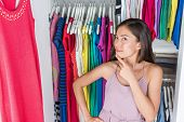 Home closet or store clothing rack changing room. Woman choosing her fashion outfit. Shopping girl t poster