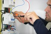 foto of breaker  - Man working on a circuit breaker - JPG