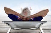Senior man relaxing in a deck chair