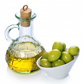 Extra Virgin Olive Oil and Green Olives over white