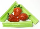 picture of ceres  - fresh green cerely stem with red strawberry - JPG