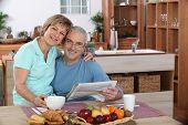Portrait of an elderly couple at breakfast