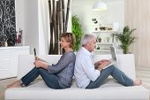 Senior couple in front of a laptop computer