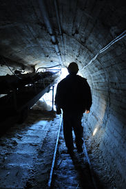 image of iron ore  - miner is emerging from a mine in sicily - JPG