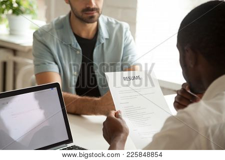 African American Hr Manager Holding Applicants Curriculum Vitae At