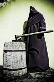 stock photo of beheaded  - an old dark executioner with the axe - JPG