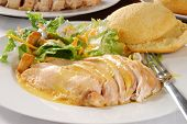 picture of biscuits gravy  - Sliced chicken breast smothered in gravy with a green salad - JPG