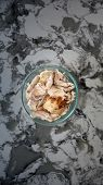 Shredded roast white chicken meat in a glass bowl on a marble counter top. most downloaded chicken m poster