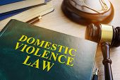 Domestic Violence Law On A Wooden Table. poster