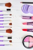 Make Up Brushes And Cosmetics Set. Decorative Cosmetics On White Wooden Background, Top View. Collec poster