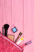 Cosmetics Bag With Makeup Products, Top View. Cosmetics And Makeup Tools In Pink Toiletry Bag, Copy  poster