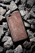 Exclusive Brown Snake Leather Case For Smartphone.luxury Case. On Stone Background poster