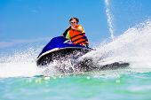 Teenager On Jet Ski. Teen Age Boy Water Skiing. poster