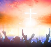 Praise And Worship Concept: Silhouette Christian People Hand Rising Over Blurred Cross On Spiritual  poster