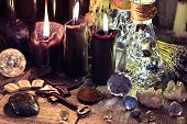 Magic Crystals, Ritual Objects, Runes, Black Candles And Bottles On Witch Table. Occult, Esoteric, D poster