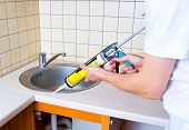 Caulking Gun Putting Silicone Sealant To Installing A Kitchen Sink