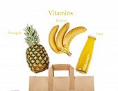 A Paper Bag With Exotic Fruits And Fruit Juice. Pineapple, Bananas And A Bottle Of Juice On A White  poster