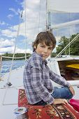 boy sailng on yacht