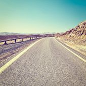 Winding Asphalt Road In The Negev Desert In Israel, Instagram Effect poster