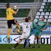 KAPOSVAR, HUNGARY - JULY 30: Lubos Hajduch (in yellow) in action at a Hungarian National Championship soccer game - Kaposvar (green) vs Videoton (white) on July 30, 2011 in Kaposvar, Hungary.