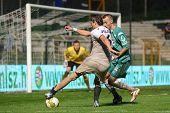 KAPOSVAR, HUNGARY - JULY 30: Dusan Vasiljevic (in white) in action at a Hungarian National Championship soccer game - Kaposvar (green) vs Videoton (white) on July 30, 2011 in Kaposvar, Hungary.