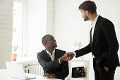 Grateful Caucasian Executive Handshaking Happy African Employee Giving Positive Feedback Congratulat poster