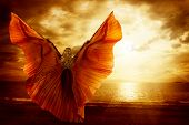 Woman Dancing Wings Dress, Fashion Art Model Flying On Ocean Sky Sunset, Beauty Imagination Concept poster