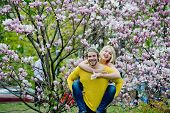 Sensual Woman And Man In Magnolia Bloom. Couple In Love In Blossoming Flower, Spring. Man And Woman  poster