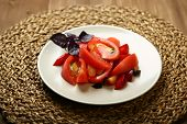 Salad Of Tomato And Red Plums With Basil For A Healthy Diet. Low-calorie Food For Body Weight Contro poster
