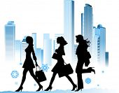 stock photo of street-walker  - Christmas shopping girls - JPG