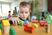 stock photo of daycare  - the child in kindergarten plays with enthusiasm - JPG
