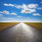 Long Straight Desert Road To Flat Horizon, With Light Streaming From Straight Ahead. poster