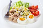 A Small Meal Of 280 Calories, Or 1046 Kilojoules, Consisting Of Half A Can Of Tuna, A Boiled Egg And poster