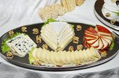 picture of cheese platter  - restaurant buffet platter of various sliced cheeses - JPG