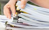 Document Report And Business Busy Concept: Asian Businessman Hands Working In Many Documents Stacks  poster