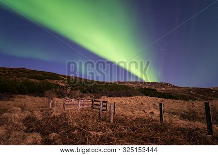 poster of The Northern Lights (other In Aurora Borealis) Over The Dark Sky In The Countryside Of Iceland The B