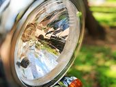 Chromed Headlamp Of A Motorcycle, Stylish Classic Chrome-plated Motorcycle Headlight poster