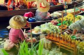 Unidentified Tourists And Traditional Vendors On The Famous Floating Market Damnoen Saduak In Bangko poster