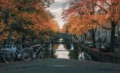 Amsterdam Canal With Its Bridges In Beautiful Fall Colors In The Old Center Of Amsterdam In The Neth poster