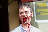 MOSCOW - MAY 14: Unidentified participant of Zombie Walk on Old Arbat shows bloody teeth, May 14, 20