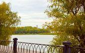 River Landscape Autumn Fence Selective Focusthe Coast Of The River, River Landscape In Autumn Fence poster