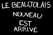 Text New Beaujolais Wine Is Arrived On A Slate In French Language poster