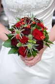 Bride Holding A Bouquet Of Roses